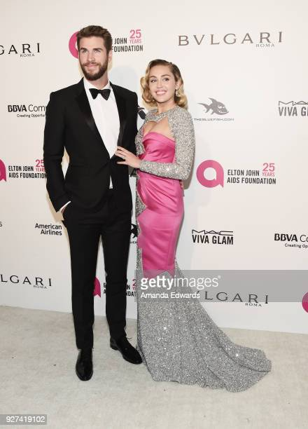 Actor Liam Hemsworth and singer Miley Cyrus arrive at the 26th Annual Elton John AIDS Foundation's Academy Awards Viewing Party on March 4 2018 in...