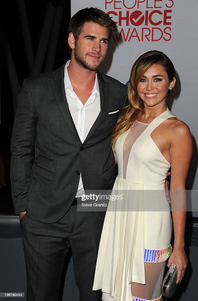 Actor Liam Hemsworth (L) and singer Miley Cyrus arrive at the People's Choice Awards 2012 at Nokia Theatre LA Live on January 11, 2012 in Los Angeles, California.