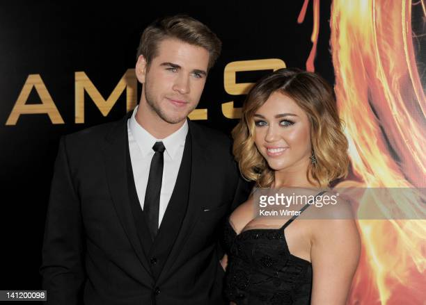 Actor Liam Hemsworth and singer Miley Cyrus arrive at the premiere of Lionsgate's 'The Hunger Games' at Nokia Theatre LA Live on March 12 2012 in Los...