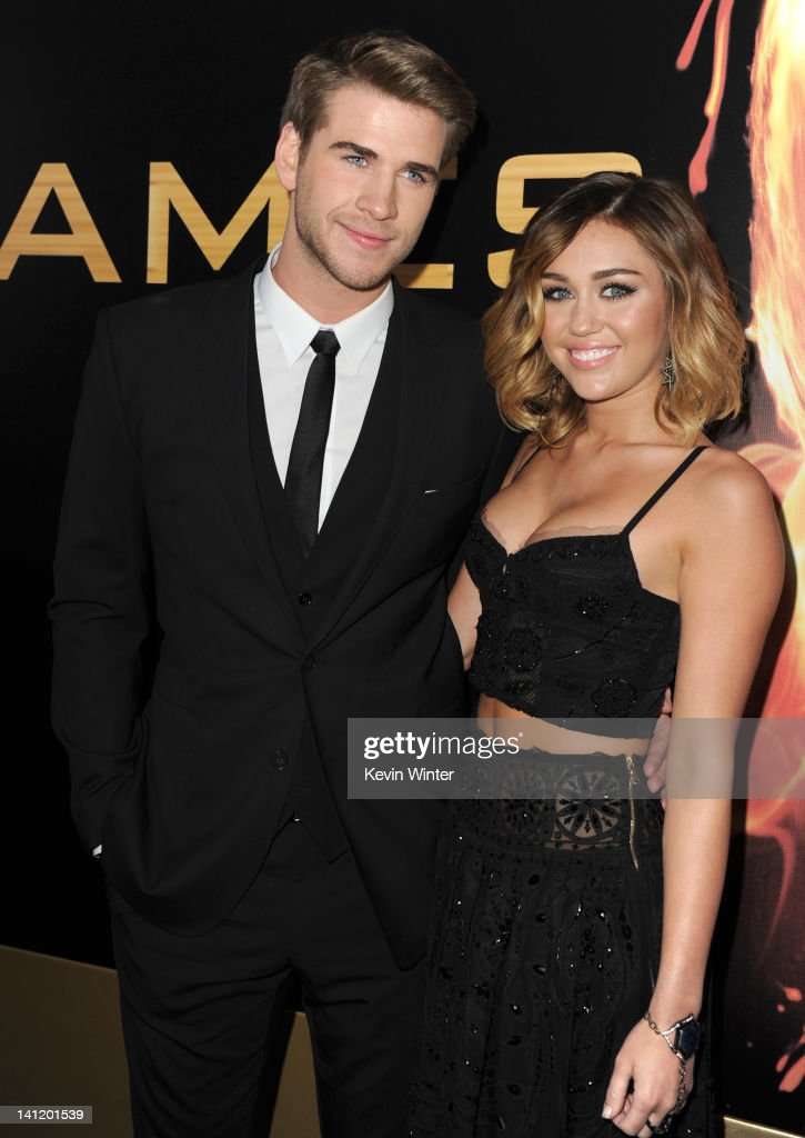 Actor Liam Hemsworth (L) and singer Miley Cyrus arrive at the premiere of Lionsgate's 'The Hunger Games' at Nokia Theatre L.A. Live on March 12, 2012 in Los Angeles, California.