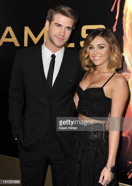 Actor Liam Hemsworth and singer Miley Cyrus arrive at the premiere of Lionsgate's The Hunger Games at Nokia Theatre LA Live on March 12 2012 in Los...