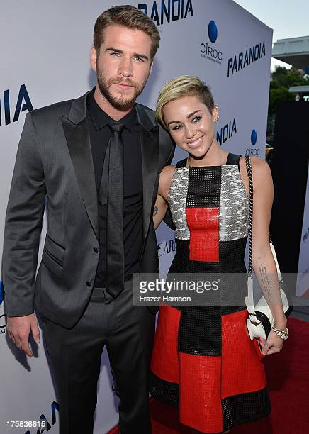 Actor Liam Hemsworth and singer Miley Cyrus attend the premiere of Relativity Media's Paranoia at DGA Theater on August 8 2013 in Los Angeles...