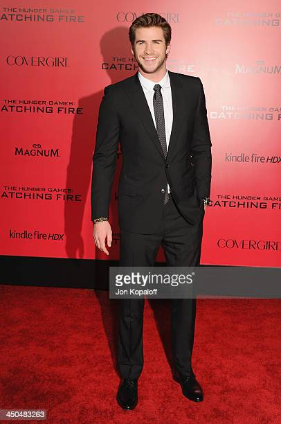 """Actor Liam Hemsworth arrives at the Los Angeles Premiere """"The Hunger Games: Catching Fire"""" at Nokia Theatre L.A. Live on November 18, 2013 in Los..."""