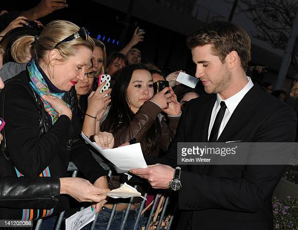 Actor Liam Hemsworth arrives at the premiere of Lionsgate's The Hunger Games at Nokia Theatre LA Live on March 12 2012 in Los Angeles California