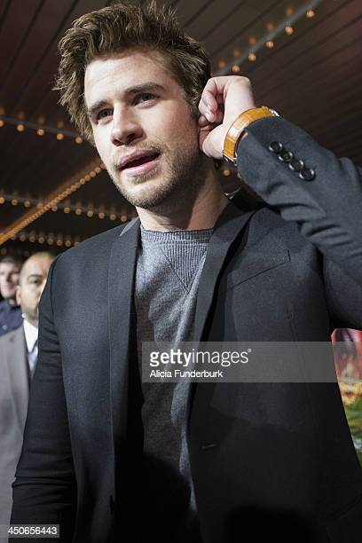 """Actor Liam Hemsworth attends the """"Hunger Games: Catching Fire"""" Knoxville Screening at Regal Pinnacle Stadium 18 on November 19, 2013 in Knoxville,..."""