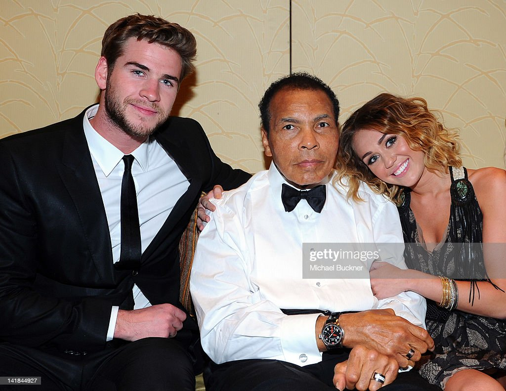 Actor Liam Hemsworth, Muhammad Ali, and singer Miley Cyrus pose backstage during Muhammad Ali's Celebrity Fight Night XVIII held at JW Marriott Desert Ridge Resort & Spa on March 24, 2012 in Phoenix, Arizona.