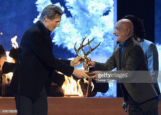 Actor Liam Neeson accepts the Biggest Ass Kicker award from actor Sir Ben Kingsley onstage during Spike TV's Guys Choice 2015 at Sony Pictures...