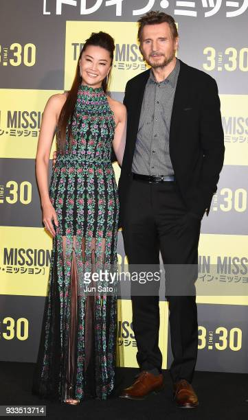 Actor Liam Neeson and actress Arisa Mizuki attend the premier event for 'The Commuter' at Toho Cinema Roppongi Hills on March 18 2018 in Tokyo Japan