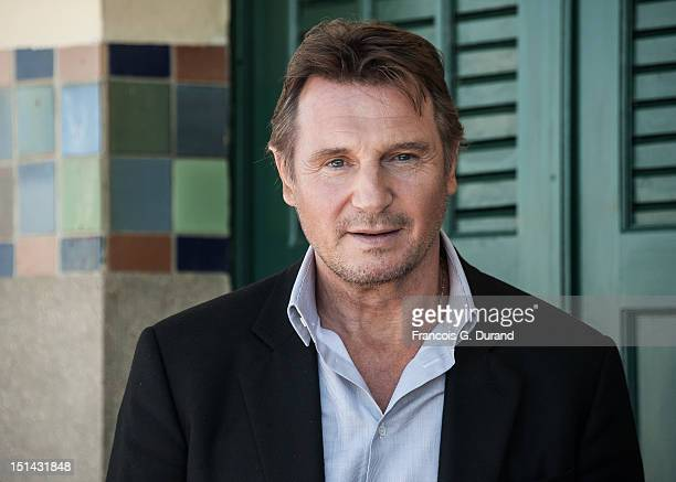 "Actor Liam Neeson poses next to the beach closet dedicated to him on the Promenade des Planches for the movie ""Taken 2"" during the 38th Deauville..."