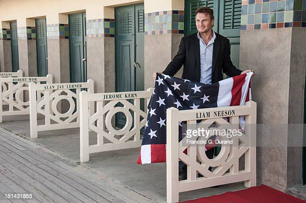 Actor Liam Neeson poses next to the beach closet dedicated to him on the Promenade des Planches for the movie 'Taken 2' during the 38th Deauville...