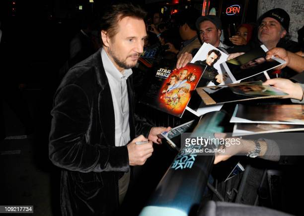Actor Liam Neeson signs autographs at Warner Bros Los Angeles Premiere of 'Unknown' held at Regency Village Theatre on February 16 2011 in Westwood...