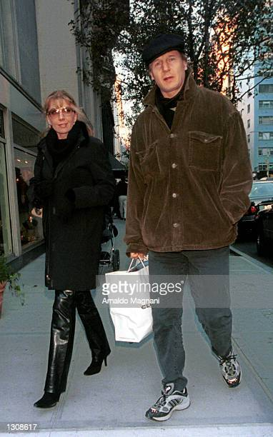 Actor Liam Neeson with actress wife Natasha Richardson shop along Madison Avenue December 2 2000 in New York City