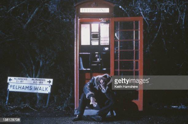 Actor Liam Neesonin a phonebooth on Pelhams Walk in the thriller 'Under Suspicion' 1991