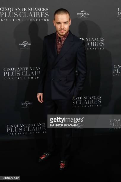 Actor Liam Payne poses as he arrives to attend 'Fifty Shades Freed 50 Nuances Plus Claires' Premiere at Salle Pleyel in Paris on February 6 2018 /...