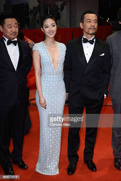 Actor Liao Fan actress Gwei Lun Mei and actor Wang Xuebing attend the 'Black Coal Thin Ice' premiere during 64th Berlinale International Film...