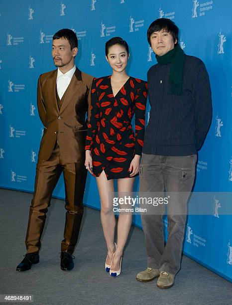 Actor Liao Fan actress Gwei Lun Mei and director Diao Yinan attend the 'Black Coal Thin Ice' photocall during 64th Berlinale International Film...