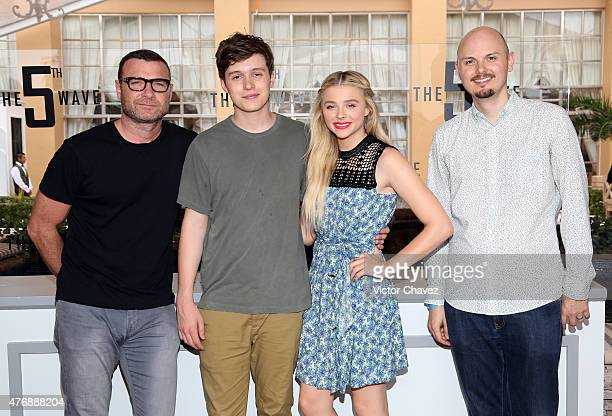 Actor Liev Schreiber actor Nick Robinson actress Chloe Grace Moretz and director J Blakeson attend The 5th Wave photo call during Summer Of Sony...