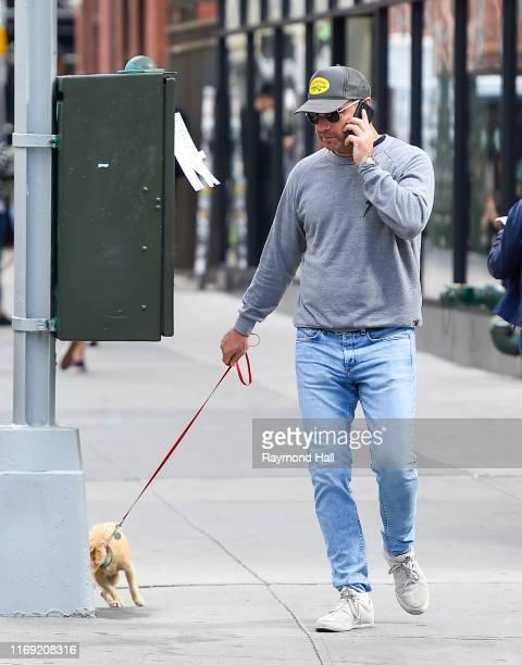 Actor Liev Schreiber is seen walking is dog in soho on September 18 2019 in New York City