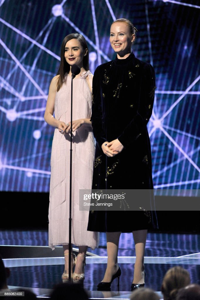 Actor Lily Collins (L) and Breakthrough Prize co-founder Julia Milner speak onstage during the 2018 Breakthrough Prize at NASA Ames Research Center on December 3, 2017 in Mountain View, California.