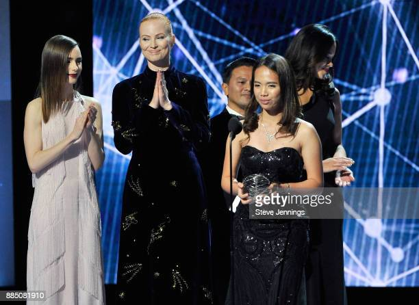 Actor Lily Collins Breakthrough Prize cofounder Julia Milner and Breakthrough Junior Challenge Winner Hillary Diane A Andales onstage at the 2018...