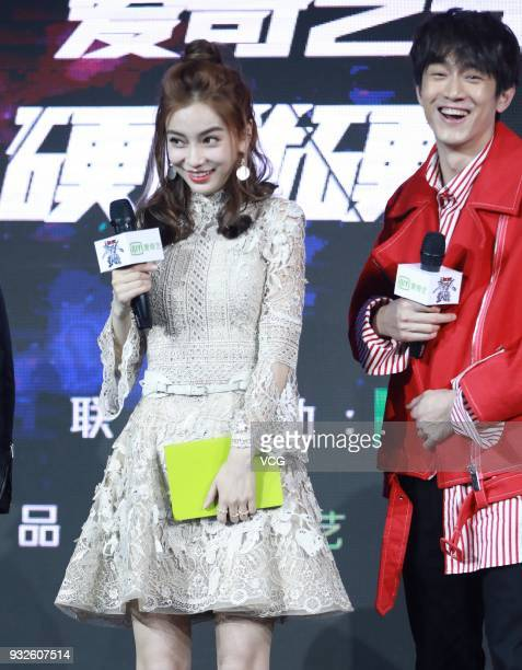 Actor Lin Gengxin and actress Angelababy attend the press conference of variety show 'Clash Bots' on March 15 2018 in Beijing China