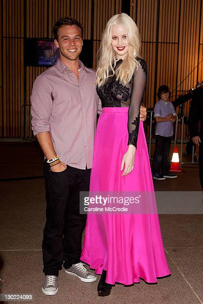 Actor Lincoln Lewis with finalist Simone Holtznagel attends Australia's Next Top Model Season 7 live finale at the Sydney Opera House on October 25...