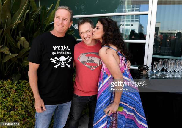 Actor Linden Ashby executive producer Jeff Davis and actor Melissa Ponzio from 'Teen Wolf' celebrate their final season backstage after their Hall H...
