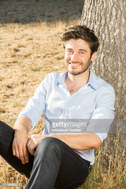 Actor Lino Guanciale leaning against a tree Rome Italy 28th July 2017