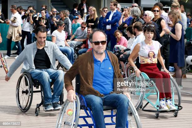 Actor Lionel Abelanski and Journalist Erika Moulet attend the Race during the 'All in Wheelchair Day' as part ofthe 2017 French Tennis Open Day...