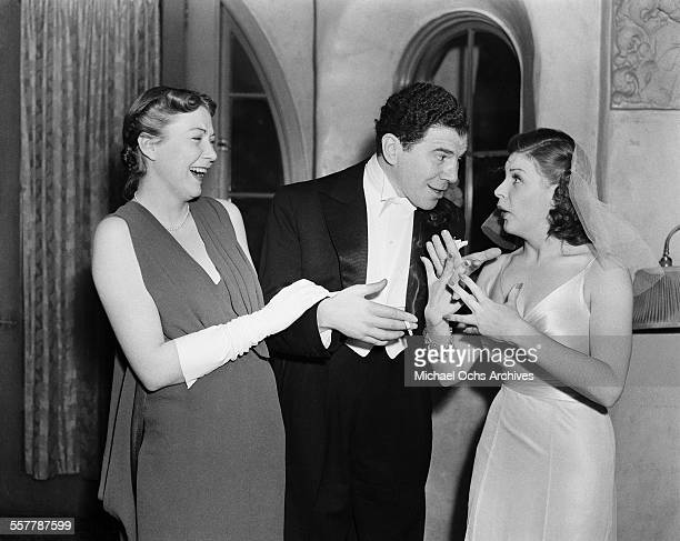 Actor Lionel Stander laughs with actress Martha Raye during an event in Los Angeles California