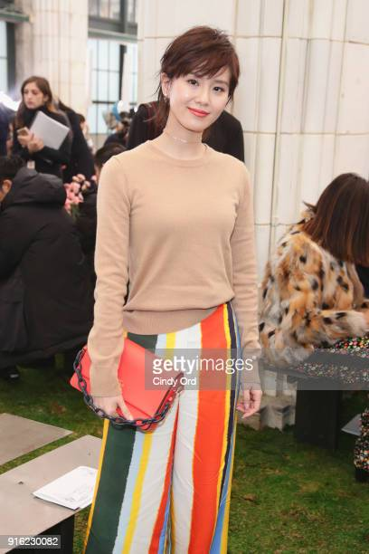 Actor Liu Shishi attends the Tory Burch Fall Winter 2018 Fashion Show during New York Fashion Week at Bridge Market on February 9 2018 in New York...