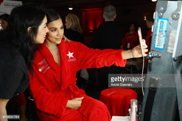 Actor Liz Hernandez prepares backstage at the American Heart Association's Go Red For Women Red Dress Collection 2018 presented by Macy's at...