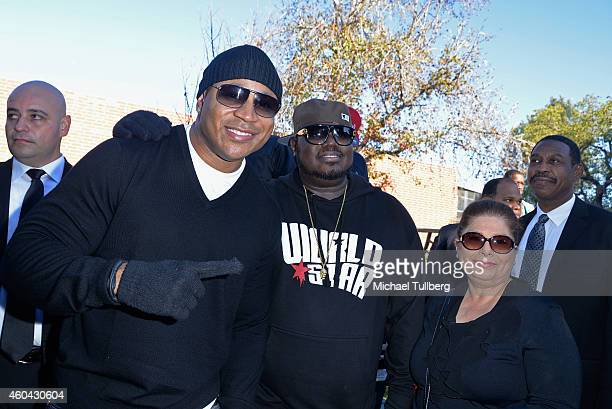 Actor LL Cool J and Worldstar HipHop founder Lee 'Q' O'Denat pose at Worldstar Foundation's 2nd Annual Skid Row Christmas Giveaway at Rotary House...