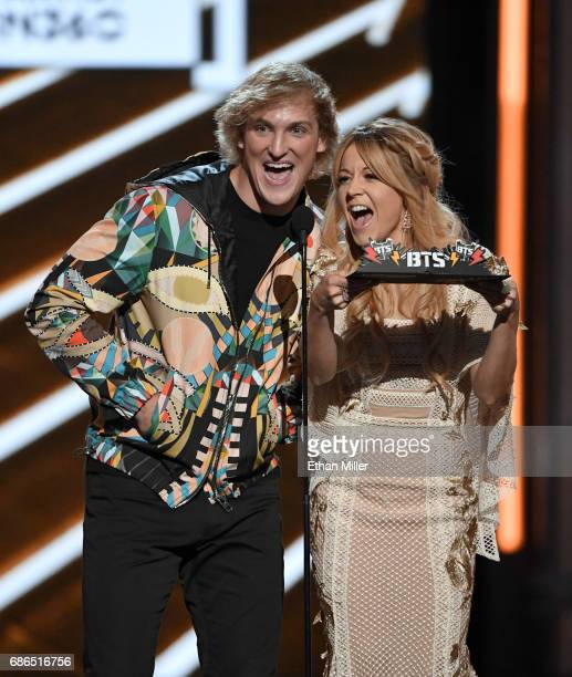Actor Logan Paul and recording artist Lindsey Stirling present an award onstage during the 2017 Billboard Music Awards at TMobile Arena on May 21...