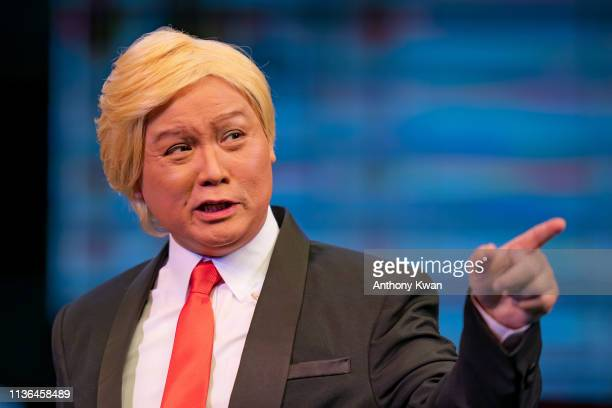 Actor Loong Koon Tin dressed as US President Donald Trump acts on stage during a rehearsal of a Cantonese opera Trump on Show on April 11 2019 in...