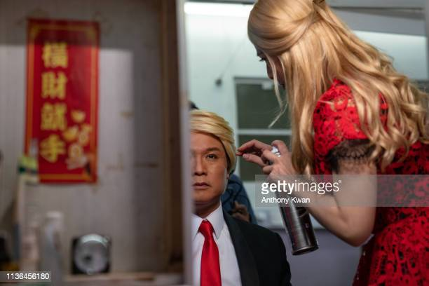 Actor Loong Koon Tin dressed as US President Donald Trump prepares in backstage during a rehearsal of a Cantonese opera Trump on Show on April 11...