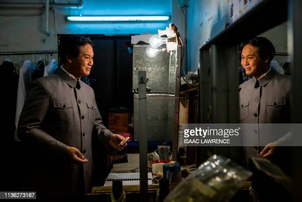 Actor Loong Koontin dressed as the late Chinese leader Mao Zedong prepares back stage during a rehearsal of a Cantonese opera called Trump on Show in...
