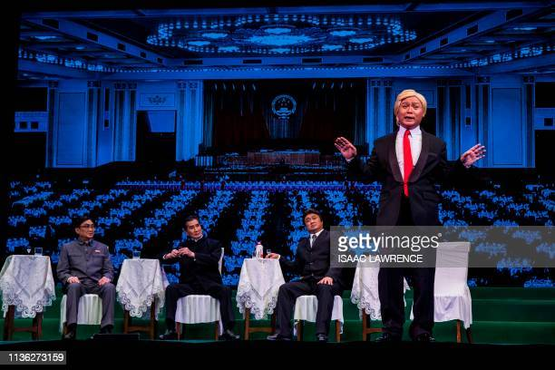 Actor Loong Koontin dressed as US President Donald Trump performs on stage during a rehearsal of a Cantonese opera called Trump on Show in Hong Kong...