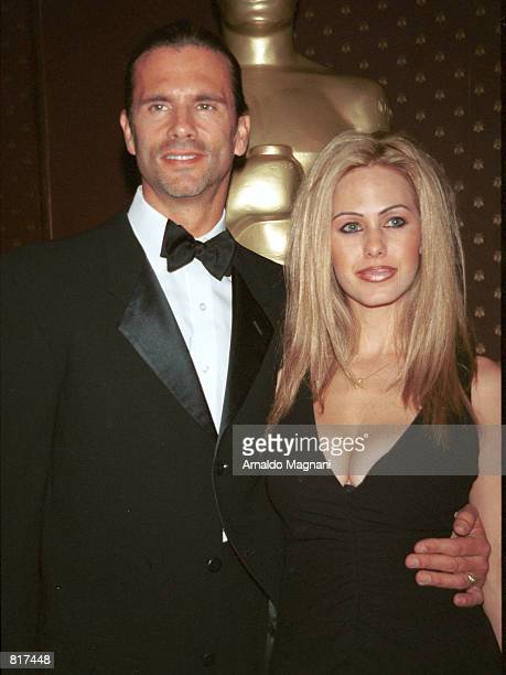 Actor Lorenzo Lamas and his wife Shauna Sand arrive at Le Cirque restaurant for an Oscar night celebration March 25 2001 in New York City
