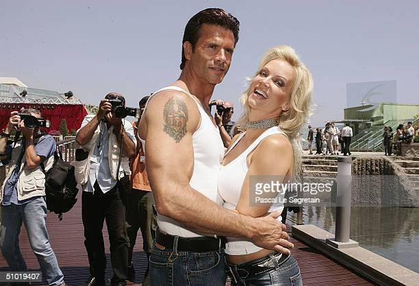 Actor Lorenzo Lamas arrives with his fiance Barbara Moore to attend a photocall at the 44th Monte-Carlo Television Festival on July 2, 2004 in Monte...