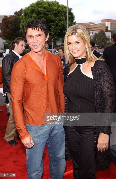 Actor Lou Diamond Phillips and his wife attend the premiere of Columbia Pictures'/Revolution Studios' film Hollywood Homicide at the Mann Village...