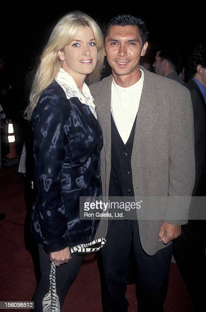 Actor Lou Diamond Phillips and wife Kelly Preston attending the premiere of 'Devil in a Blue Dress' on September 22 1995 at the Academy Theater in...
