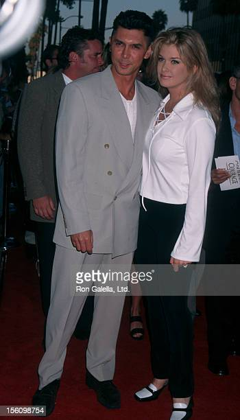 Actor Lou Diamond Phillips and wife Kelly Preston attending the premiere of 'Courage Under Fire' on July 8 1996 at the Academy Theater in Beverly...