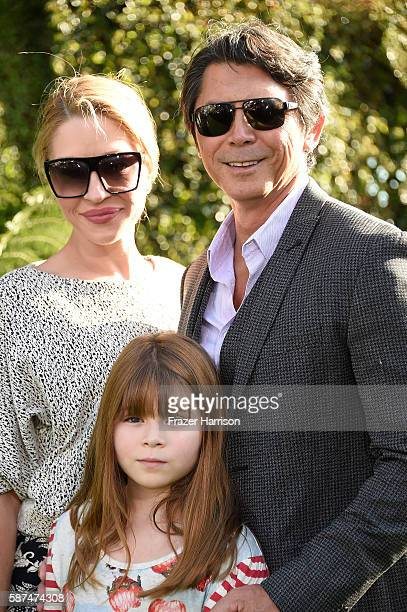 Actor Lou Diamond Phillips with Yvonne Boismier Phillips and Indigo Sanara Phillips attend the premiere of Disney's Pete's Dragon at the El Capitan...