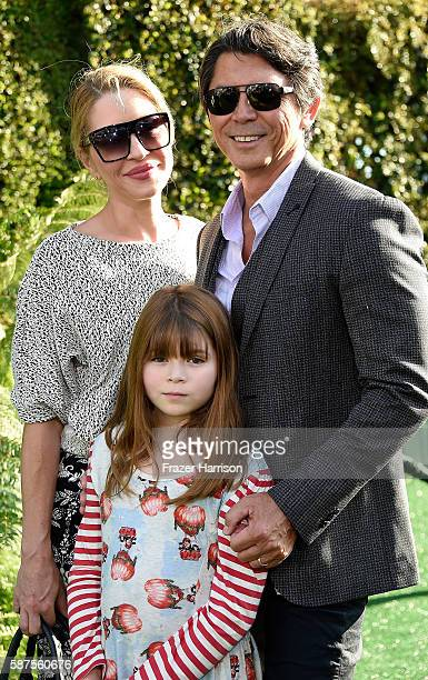 Actor Lou Diamond Phillips Yvonne Boismier Phillips and dughter Indigo Sanara Phillips arrive at the Premiere Of Disney's Pete's Dragon at the El...