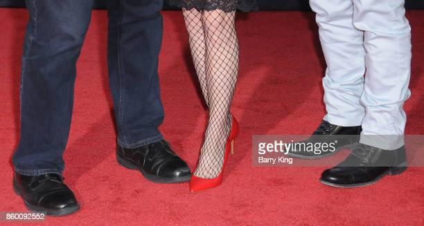 Actor Lou Ferigno wife Carla Ferigno and son actor Lou Ferigno Jr shoe detail attend the World premiere of Disney and Marvel's 'Thor Ragnarok' at El...