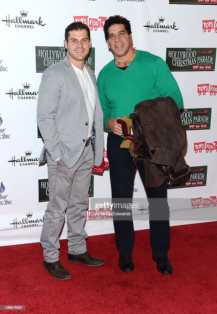 Actor Lou Ferrigno (R) and his son Lou Ferrigno Jr. arrive at the 2012 Hollywood Christmas Parade Benefiting Marine Toys For Tots on November 25, 2012 in Hollywood, California.