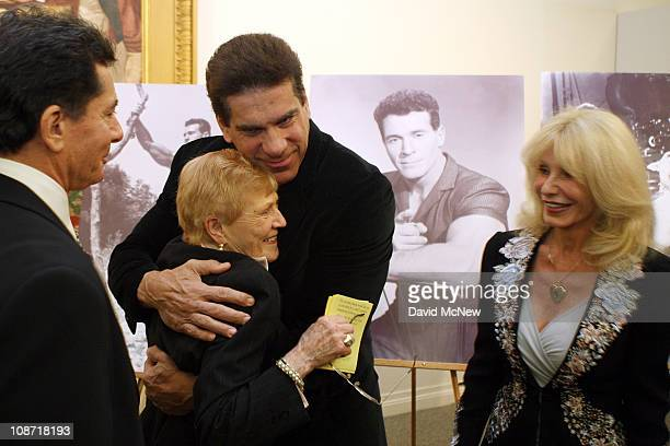 Actor Lou Ferrigno hugs Elaine LaLanne widow of the first television fitness guru Jack LaLanne as his wife Carla Ferrigno looks on before the start...
