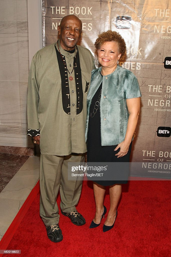 Actor Louis Gossett Jr. (L) and Debra L. Lee attend 'The Book of Negroes' screening reception at The National Archives on January 22, 2015 in Washington, DC.