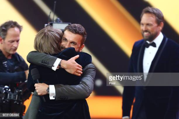 Actor Louis Hofmann with actor Edin Hasanovic and TV host Steven Gätjen on stage during the show of 'Goldene Kamera 2018' at Messehallen on February...